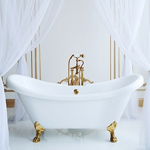 white bath tub with gold feet | crosswinds construction | Gillette, Wyoming