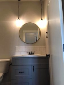 round mirror in bathroom   crosswinds construction   Gillette, Wyoming